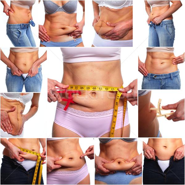 Woman belly fat. Stock photo © Kurhan