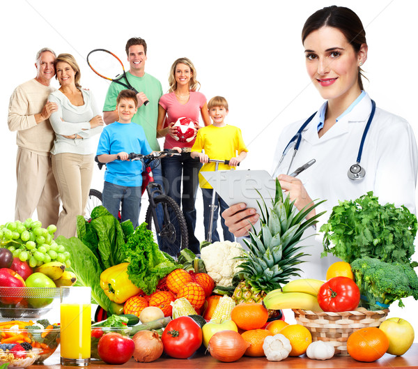 Doctor nutritionist and family. Stock photo © Kurhan