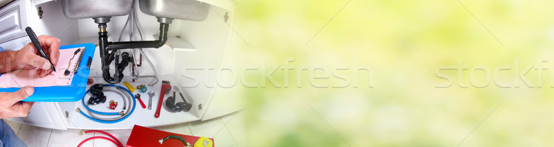 Hand of Plumber with a wrench. Stock photo © Kurhan