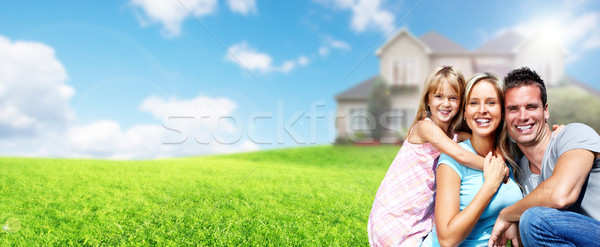 Happy family near new house. Stock photo © Kurhan