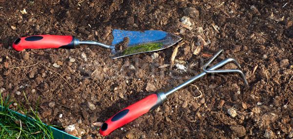 Gardening tools in the garden. Stock photo © Kurhan
