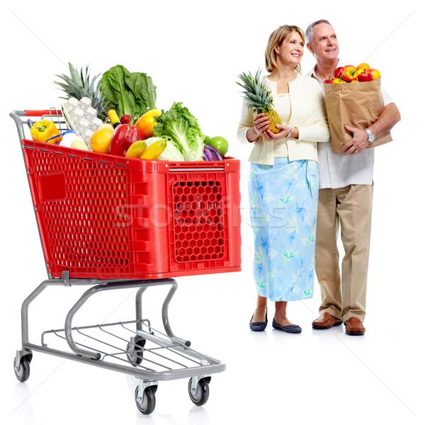 Foto stock: Feliz · casal · carrinho · de · compras · casal · de · idosos · compras · supermercado