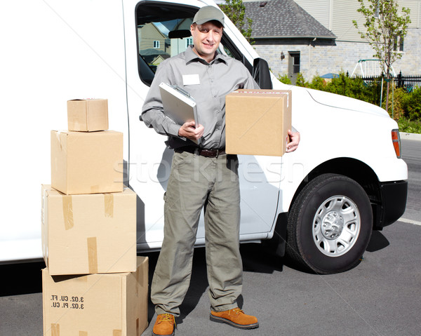 Delivery postal service man. Stock photo © Kurhan