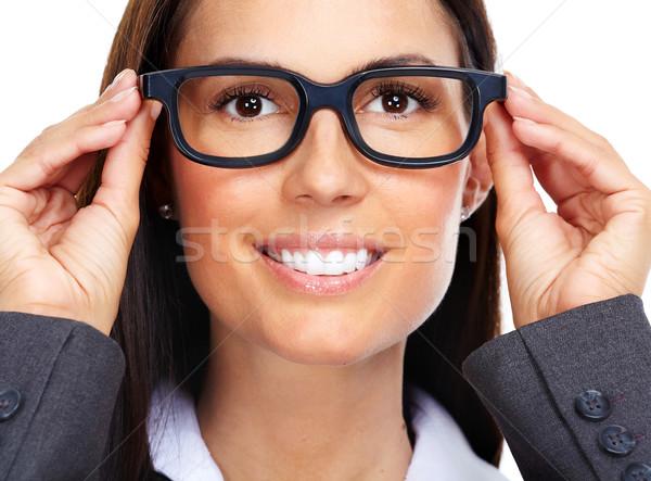 Beautiful young lady wearing eyeglasses. Stock photo © Kurhan