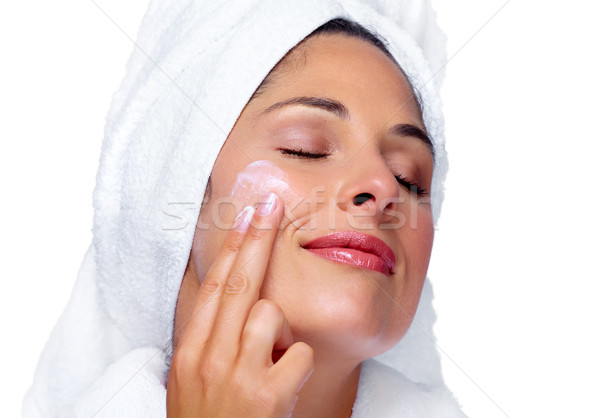 Beautiful woman face with moisturising  cream. Stock photo © Kurhan