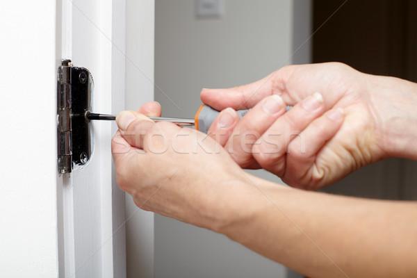Door hinge installation. Stock photo © Kurhan