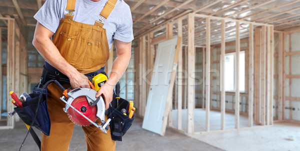 Construction worker with electric saw Stock photo © Kurhan