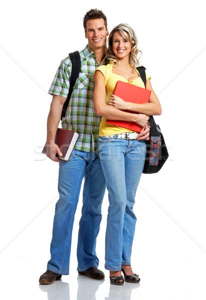 Diákok fiatal mosolyog könyvek fehér férfi Stock fotó © Kurhan