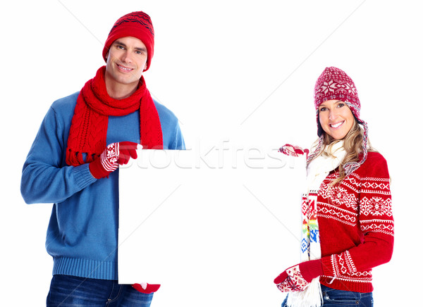 Happy couple with placard. Stock photo © Kurhan