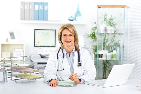 Mature doctor woman in a clinical office. Stock photo © Kurhan