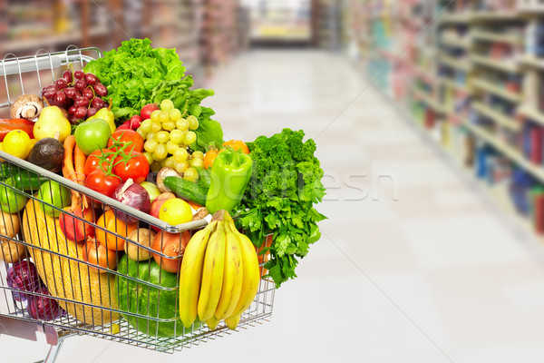 Grocery shopping cart with vegetables. Stock photo © Kurhan
