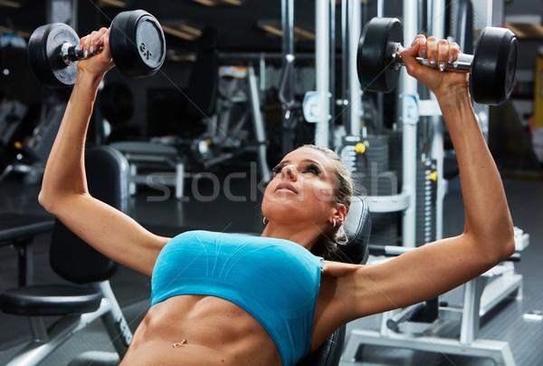Bench press workout Stock photo © Kurhan