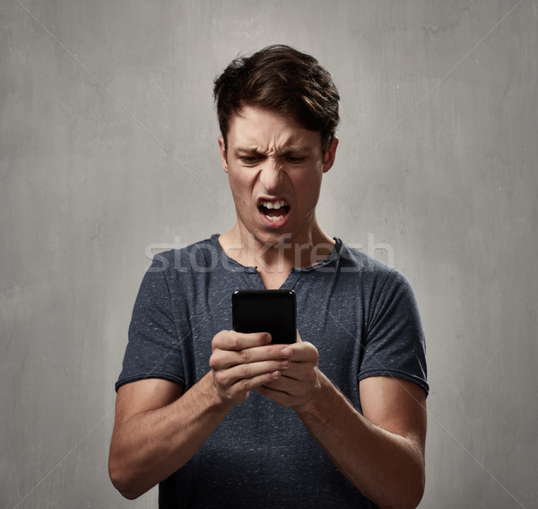 disappointed man with cell phone. Stock photo © Kurhan