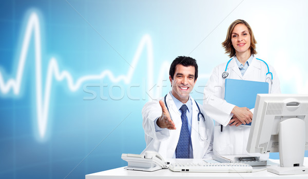 Group of medical doctors over cardio background. Stock photo © Kurhan