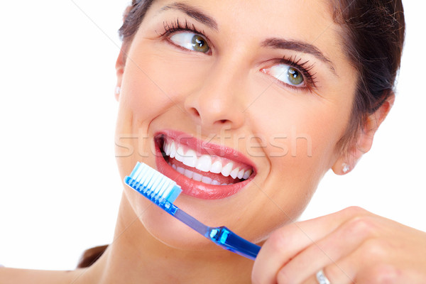 Beautiful woman smile with a toothbrush. Stock photo © Kurhan