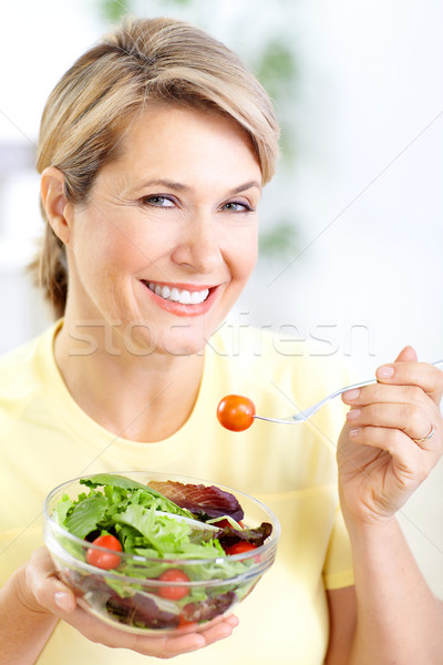 woman eating salad Stock photo © Kurhan