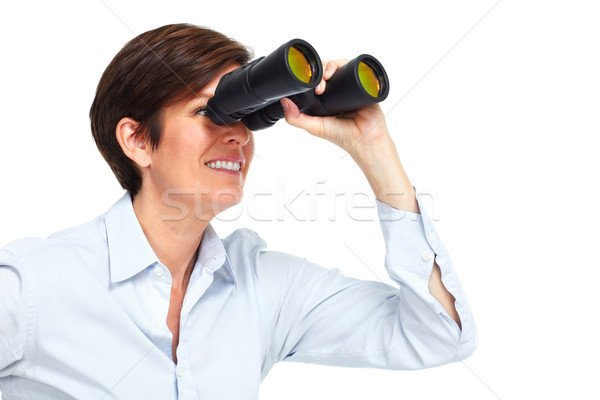 Business woman with binoculars. Stock photo © Kurhan