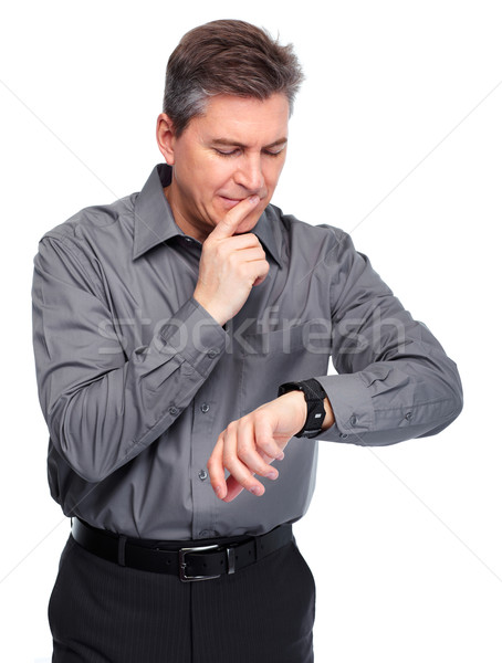 Businessman looking time at his watch. Stock photo © Kurhan