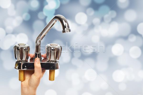 Kéz vízvezetékszerelő vízcsap ház rendbehoz építkezés Stock fotó © Kurhan