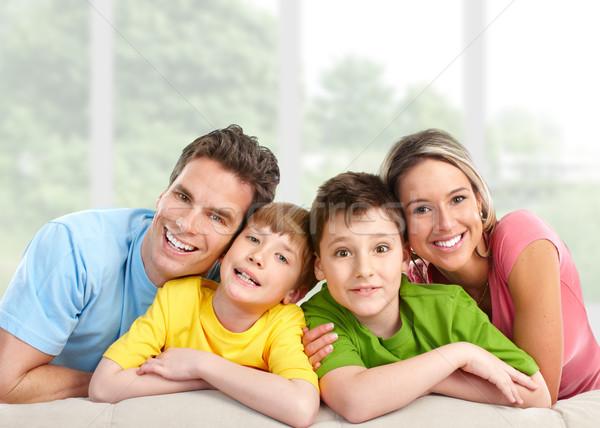 famille heureuse maison m re p re enfants femme photo stock kurhan 6570726. Black Bedroom Furniture Sets. Home Design Ideas