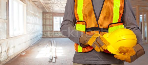 работник шлема оранжевый безопасности жилет Сток-фото © Kurhan