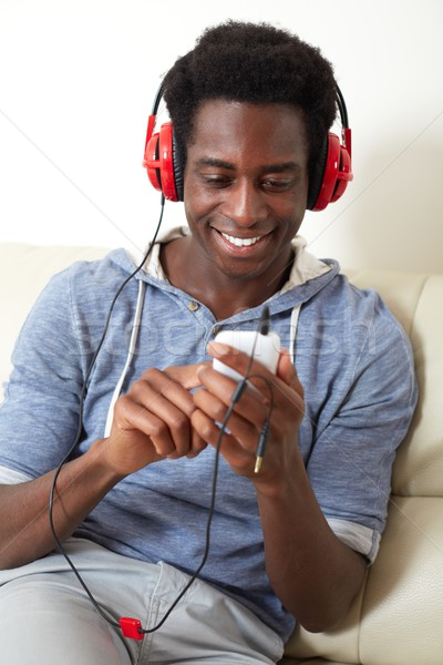 Afro-american man listening music. Stock photo © Kurhan