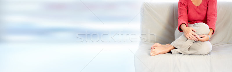 Mature lady sitting sofa Stock photo © Kurhan