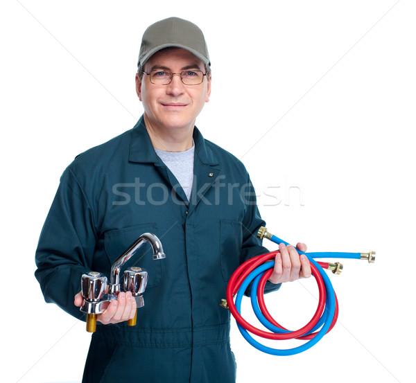 Plumber with faucet. Stock photo © Kurhan