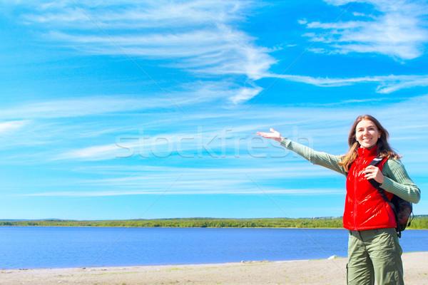 Nő fiatal mosolygó nő kék tó arc Stock fotó © Kurhan