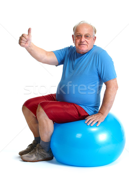 Happy senior man sitting on exercise ball. Stock photo © Kurhan