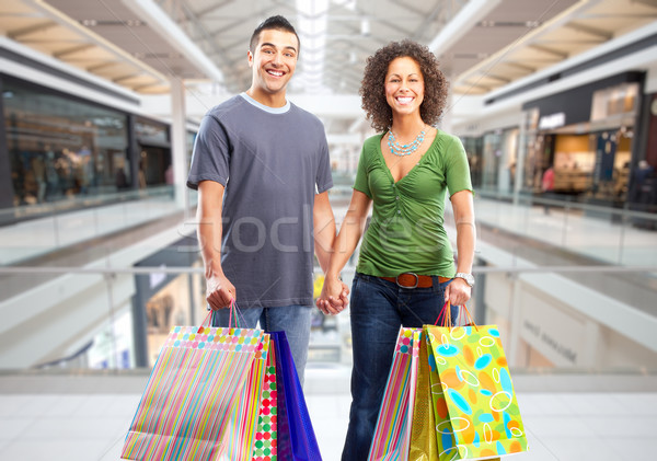 Shopping couple with paper bags. Stock photo © Kurhan