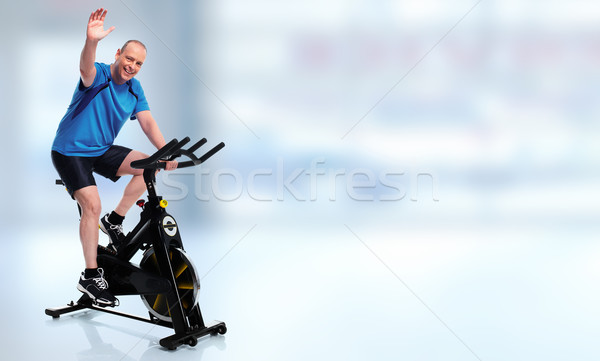 Senior Man cycling on bike trainer. Stock photo © Kurhan