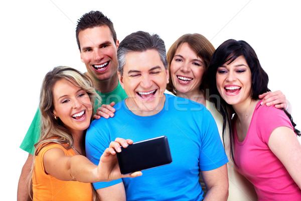 Grupo pessoas felizes tecnologia menina cara Foto stock © Kurhan