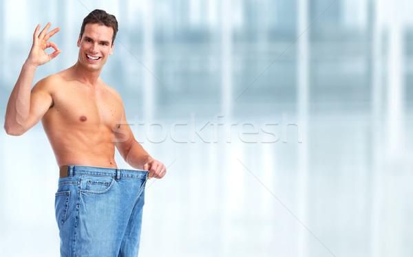 Slimming man with big size pants. Stock photo © Kurhan