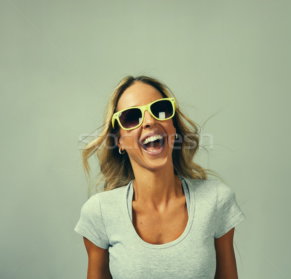 Young happy laughing girl portrait. Stock photo © Kurhan