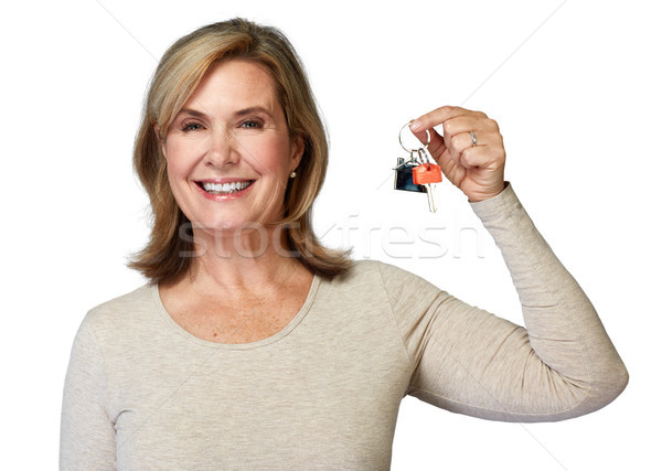 Senior realtor woman with key. Stock photo © Kurhan