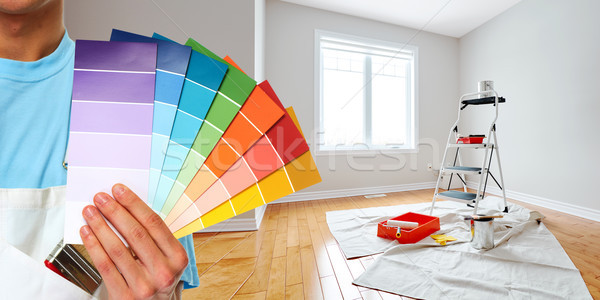 Painter hand with colors Stock photo © Kurhan