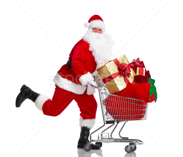 Santa Claus with gifts and shopping trolley. Stock photo © Kurhan