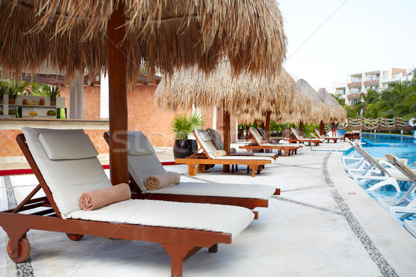 Chaise-long near swimming pool. Stock photo © Kurhan
