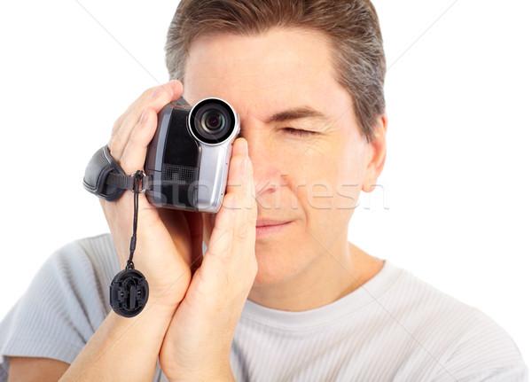 Homme caméra vidéo isolé blanche technologie jeunes Photo stock © Kurhan