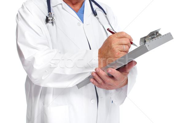 Hands of doctor writing prescription. Stock photo © Kurhan