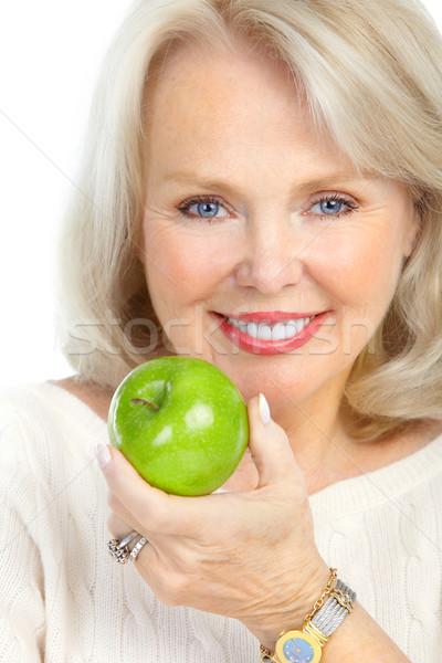 Nő érett mosolygó nő zöld alma étel Stock fotó © Kurhan