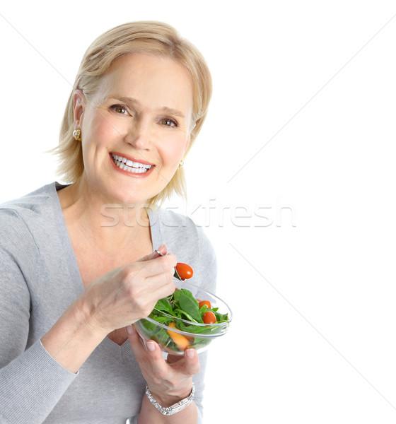 Stok fotoğraf: Kadın · yeme · salata · olgun · gülümseyen · kadın · meyve