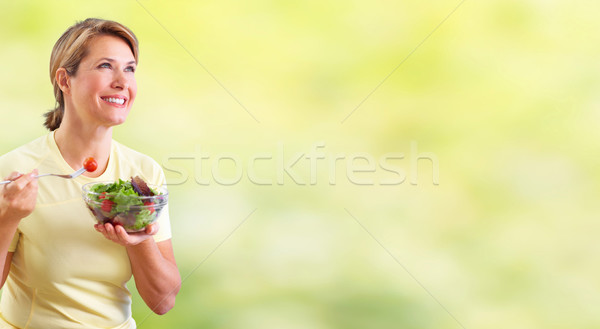 Elderly woman eating salad. Stock photo © Kurhan