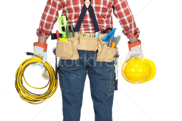 Handyman with construction tools and cable. Stock photo © Kurhan