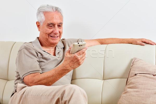 Senior man with smartphone. Stock photo © Kurhan
