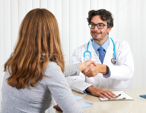 Doctor with patient Stock photo © Kurhan
