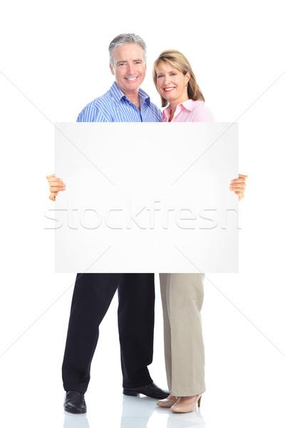 Senior happy couple with placard. Stock photo © Kurhan