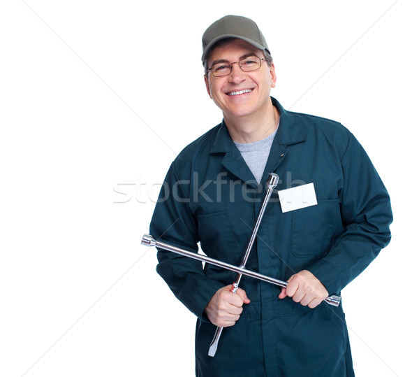 Auto mechanic with a wheel wrench. Stock photo © Kurhan