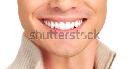Hombre guapo sonriendo aislado blanco cara hombre Foto stock © Kurhan